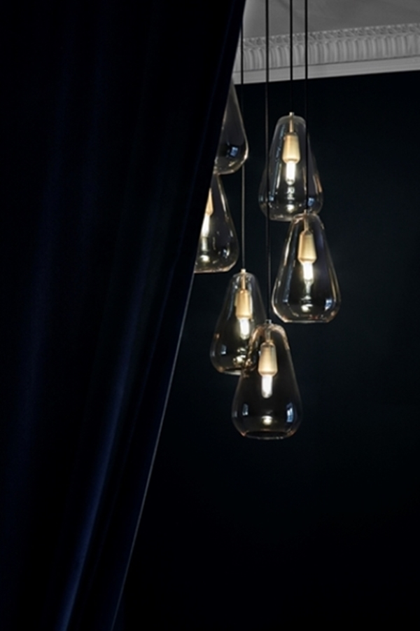 02-The-pendants-are-made-of-metal-and-hand-blown-glass-which-is-a-classic-combo-that-can-fit-any-modern-space.jpg