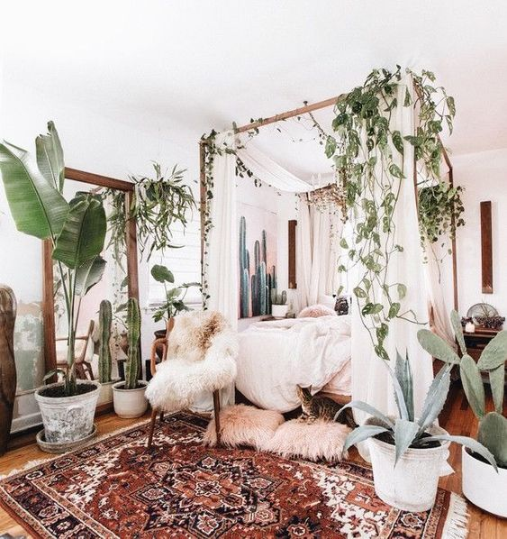 26-a-boho-rug-lots-of-greenery-and-cacti-faux-fur-and-a-canopy-bed-for-a-welcoming-boho-bedroom.jpg