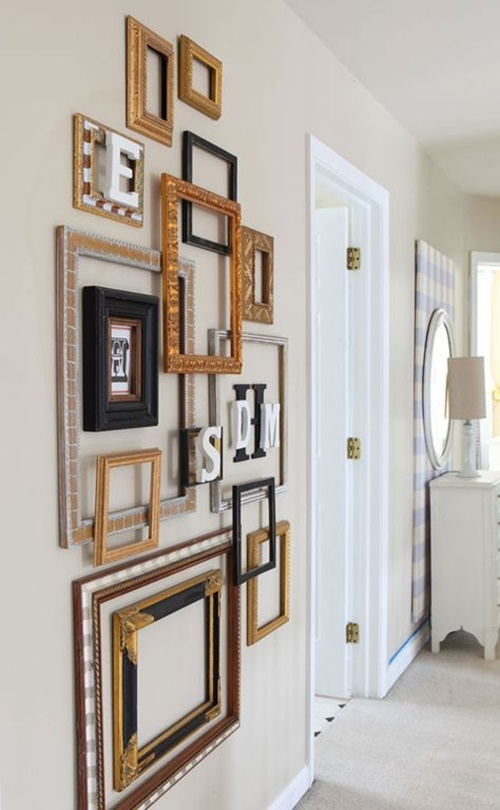 02-a-gallery-wall-of-mixed-empty-frames-and-monograms-looks-very-exquisite-and-adds-style.jpg