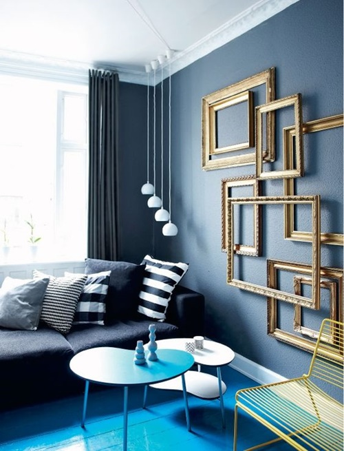 04-add-a-refined-feel-to-your-living-room-easily-hanging-a-group-of-empty-frames.jpg