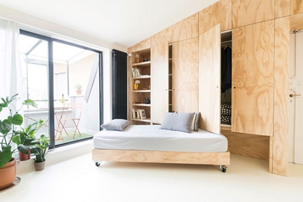 Living-room-couch-that-slides-under-the-custom-wooden-unit.jpg