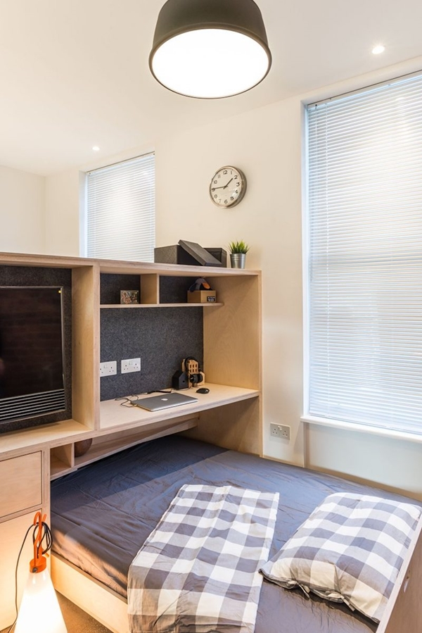 Small-London-studio-has-a-pull-out-bed-under-a-platform.jpg