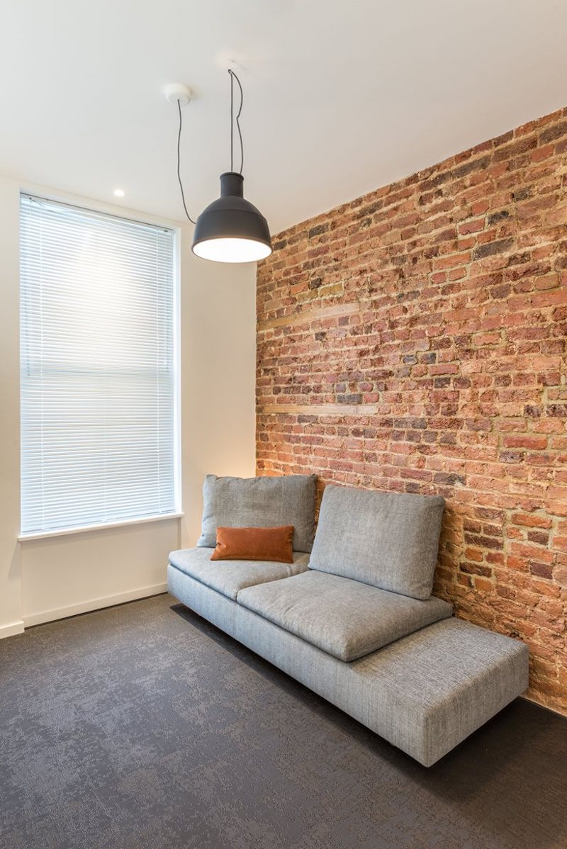 Small-London-studio-with-exposed-bricks-in-the-living-room.jpg